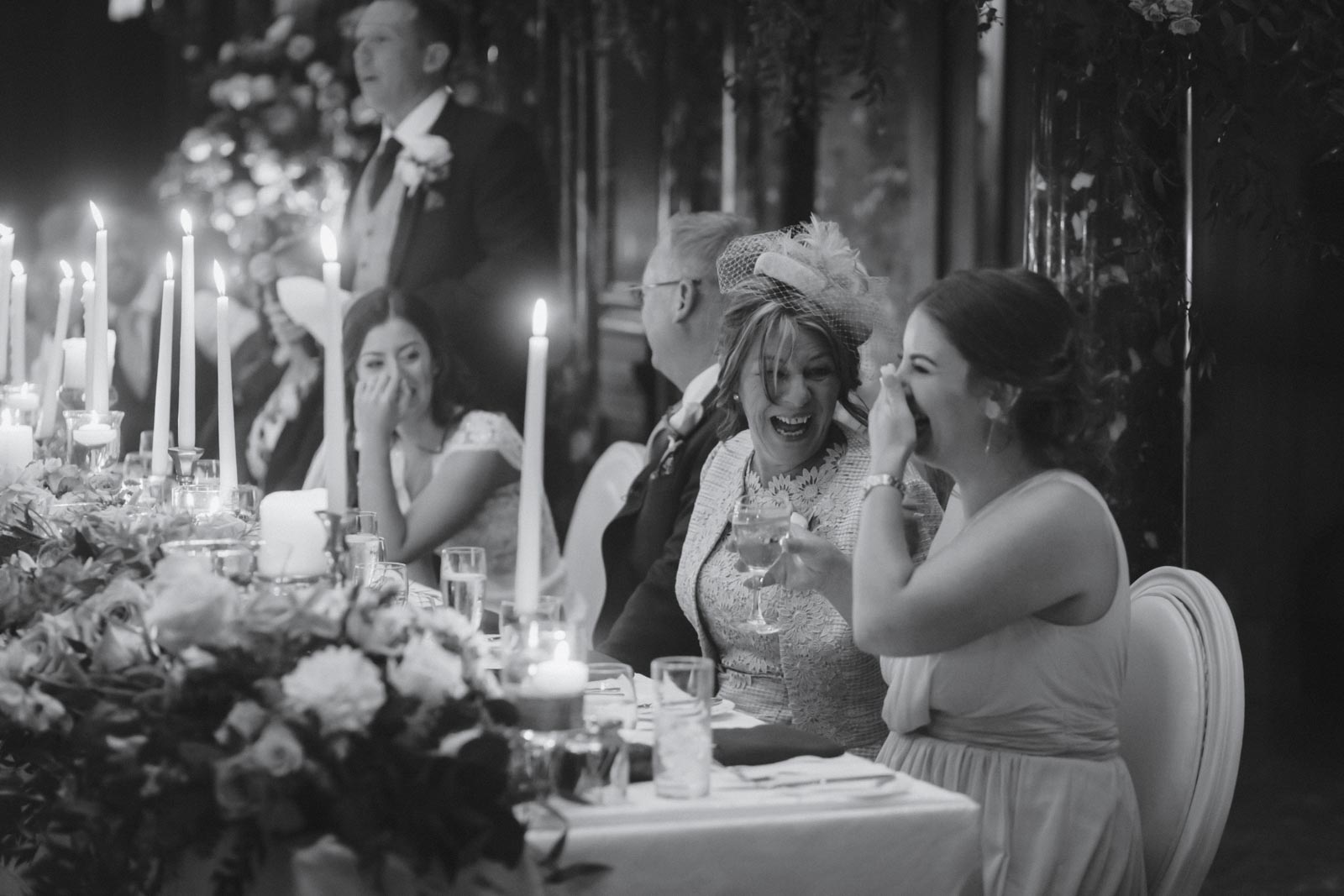 Reportage image of laughter in speeches at wedding