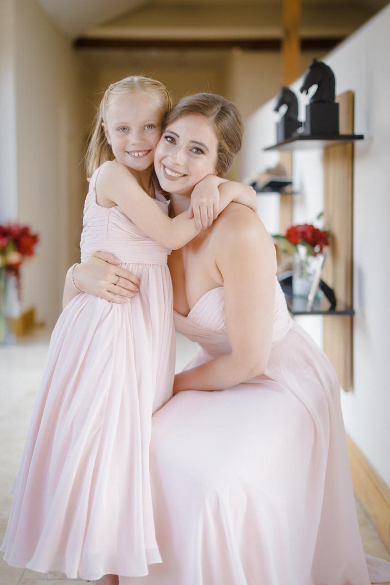 Photograph of bridesmaid and flower girl at wedding