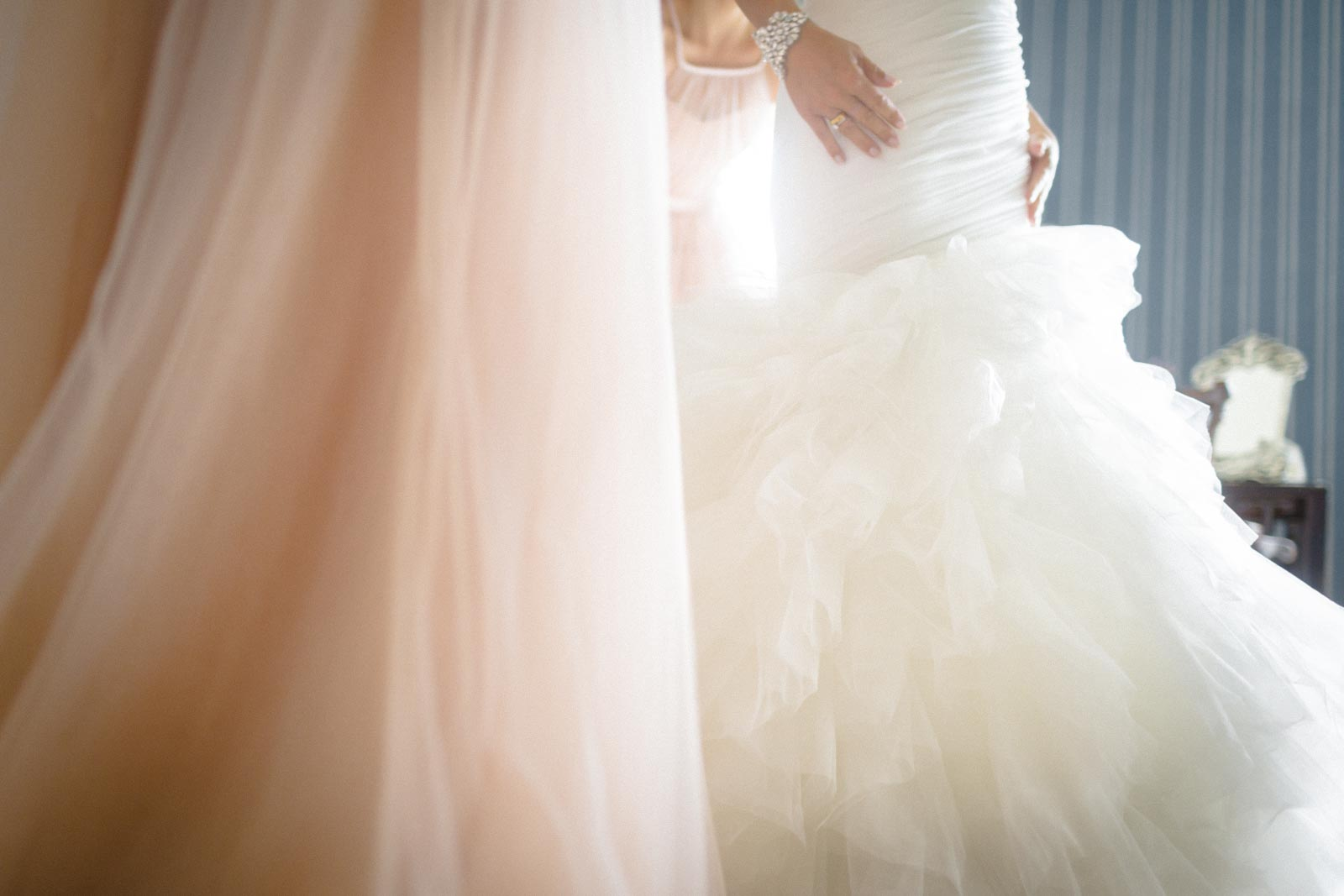 Creative fine-art wedding photograph of wedding dress